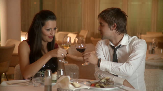 young happy couple celebrating with wine at restaurant - hoozone stock videos and b-roll footage
