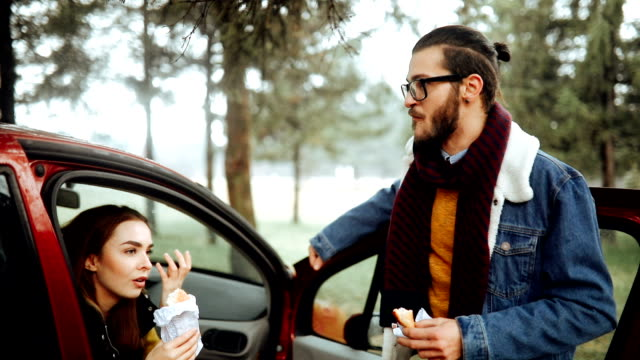 Young happy couple on a road trip during winter day