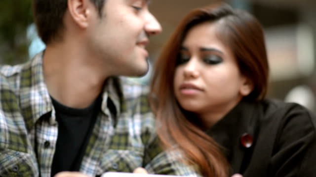 young happy couple using tablet device - middle eastern culture stock videos & royalty-free footage