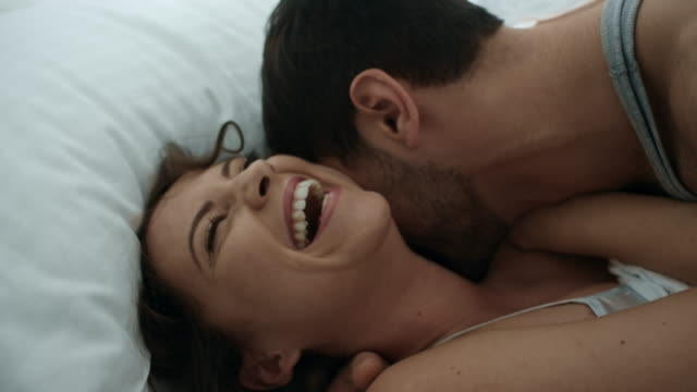young happy couple - bed stock videos & royalty-free footage