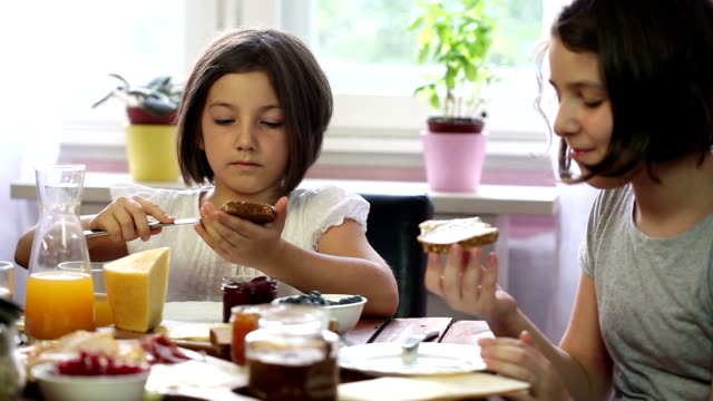 young happy family having breakfast - jam stock videos & royalty-free footage