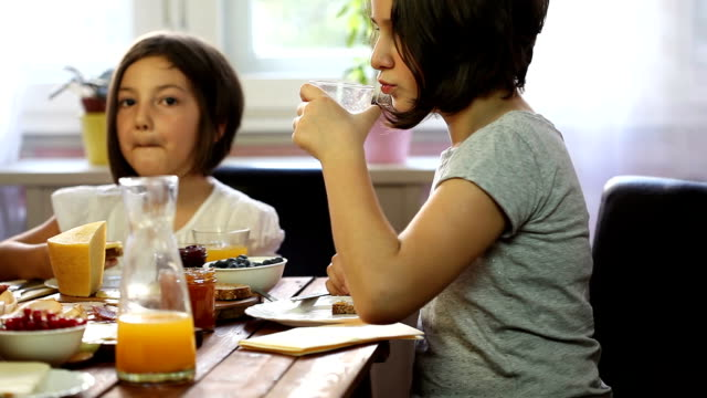 young happy family having breakfast - orange juice stock videos and b-roll footage