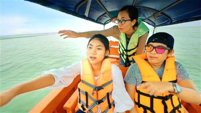 young happy people sailing on a long tail thailand boat  through the mangrove forest in southern thailand - sailor stock videos & royalty-free footage
