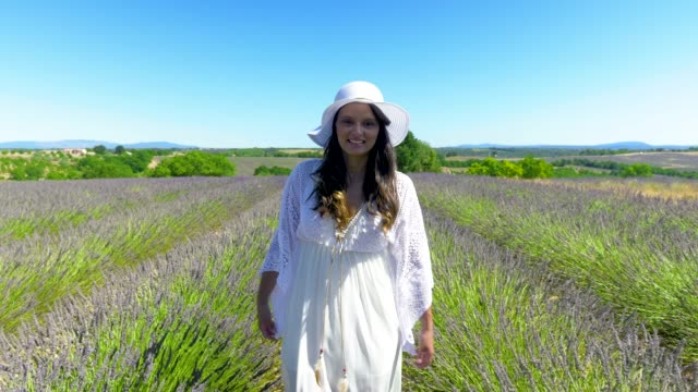 young happy woman walking in a lavender field - white dress stock videos & royalty-free footage