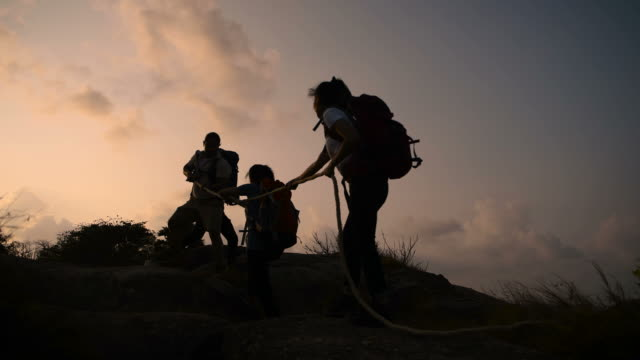 young hikers enjoy success - on top of stock videos & royalty-free footage