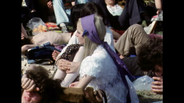 young hippies relaxing at the isle of wight festival; 1970 - sunbathing stock videos & royalty-free footage