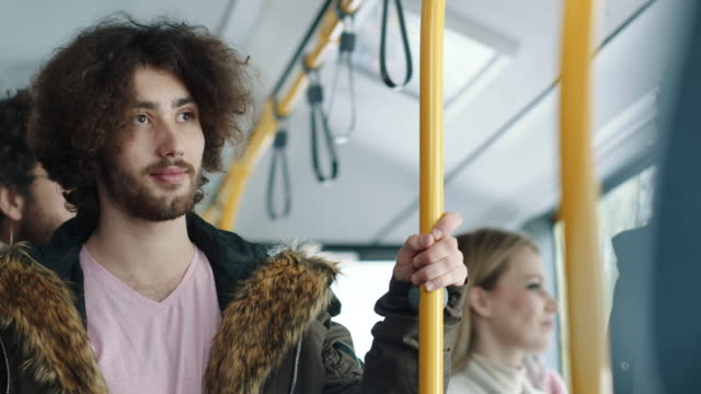 young hipster man riding on the bus - on the move stock videos & royalty-free footage