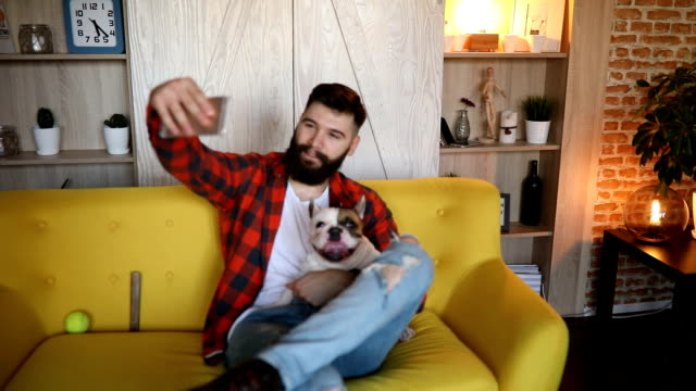 young hipster man taking selfie with his dog - barba peluria del viso video stock e b–roll