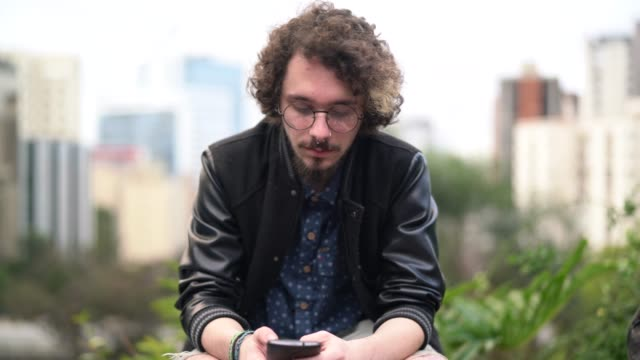 young hipster man using mobile portrait - hipster person stock videos & royalty-free footage