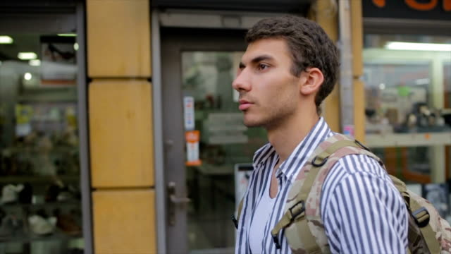 Young hipster on the journey in the city,travel concept