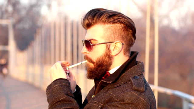 young hipster relaxes on an iron bridge - beard stock videos & royalty-free footage