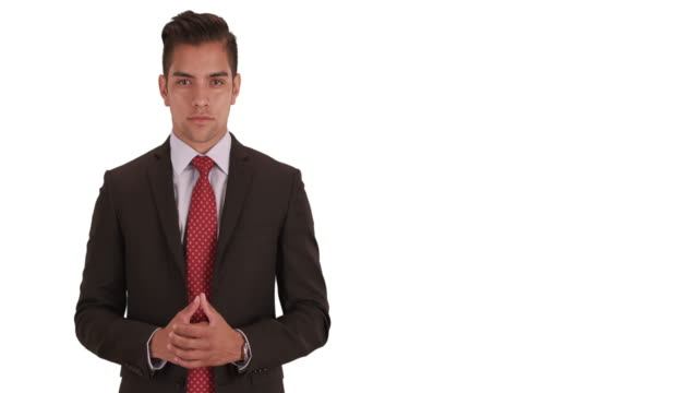 young hispanic business professional standing on white background with copy space - neckwear stock videos and b-roll footage