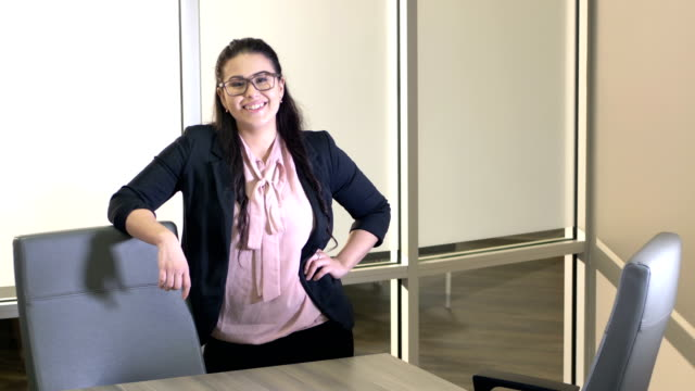 young hispanic businesswoman in boardroom - hand on hip stock videos & royalty-free footage