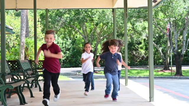 young hispanic children running together - school children stock videos & royalty-free footage