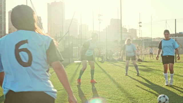 young hispanic female footballers doing passing drills - sports training drill stock videos & royalty-free footage