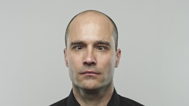 young hispanic man rolling eyes - balding stock videos & royalty-free footage