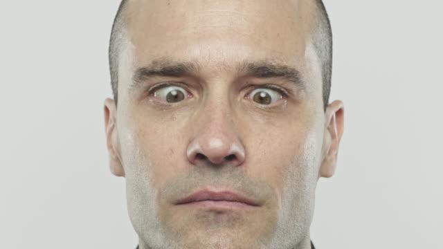 young hispanic man rolling eyes - rolling eyes stock videos & royalty-free footage