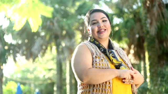 young hispanic woman in park on sunny day - body positive stock videos and b-roll footage