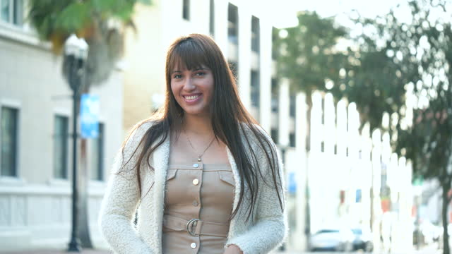 young hispanic woman in the city - cardigan sweater stock videos & royalty-free footage