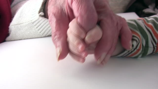 "Young holding old hands ""Generation"""