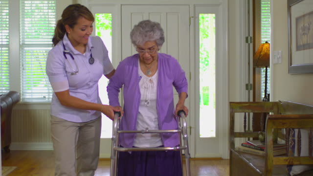 ms shaky young home health care worker helping older women with her walker, austin, texas, usa - sheltered housing stock videos & royalty-free footage