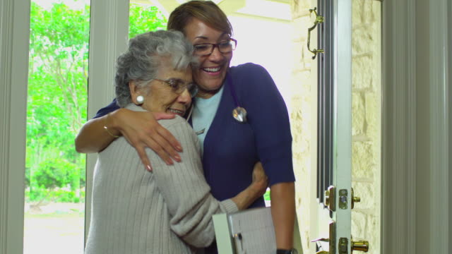 MS Young home health care worker leaving senior women's house, Austin, Texas, USA