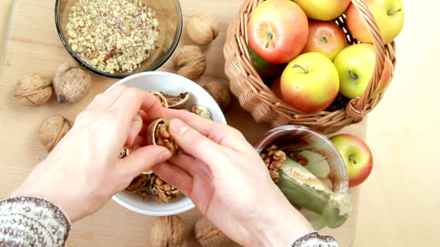 young housewife chops walnuts - nutshell stock videos & royalty-free footage