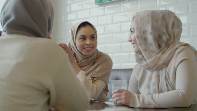 young immigrant muslim girls in cafe - amsterdam stock videos & royalty-free footage