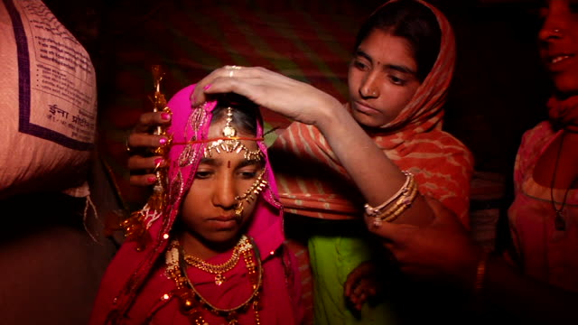 ms young indian bride being dressed for her wedding / rajasthan, india - ceremony stock videos & royalty-free footage