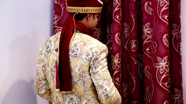 young indian groom posing for photographer on wedding day - shawl stock videos & royalty-free footage