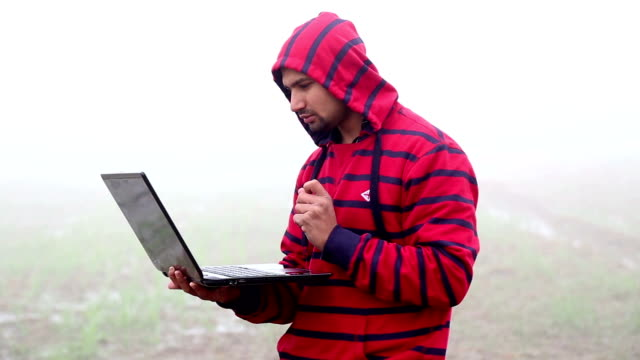 young indian men using laptop - fog stock videos & royalty-free footage