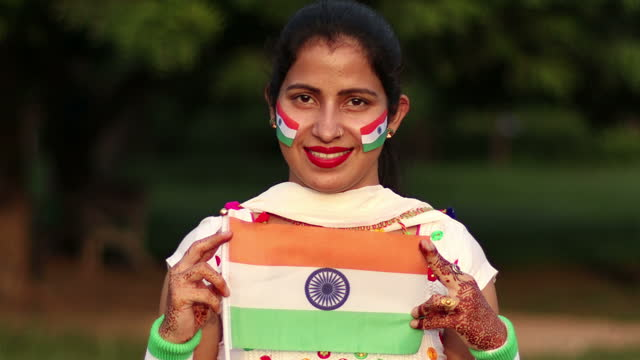 young indian woman holding tricolor indian flag in hand - 1947 stock videos & royalty-free footage
