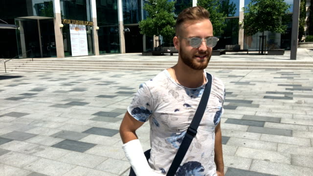Young Injured Adult Walking on City Square