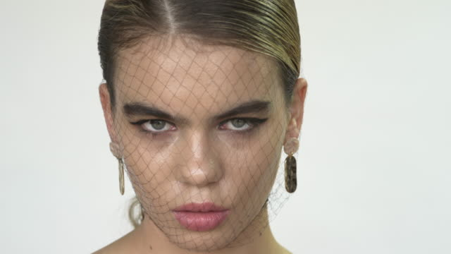 a young intense woman wearing a fishnet stocking on her head - fetish wear stock videos and b-roll footage