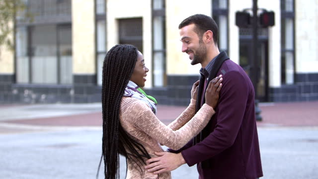young interracial couple meeting in city - boyfriend stock videos & royalty-free footage