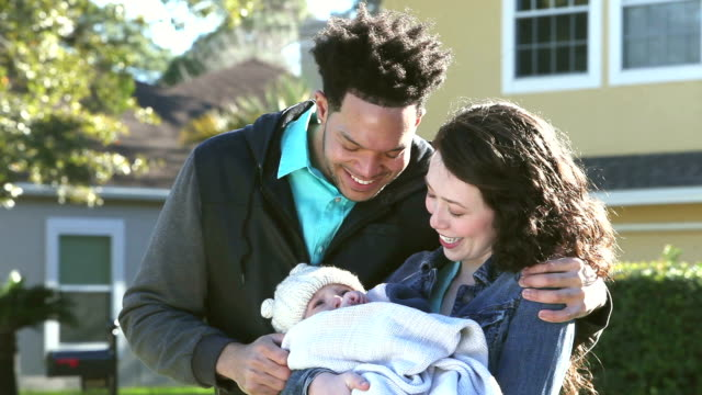 young interracial couple with baby boy - three people stock videos & royalty-free footage