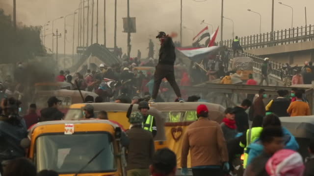 young iraqi protesters attempt to bring baghdad to a standstill as they campaign for a new election and an end to corruption - demonstrant stock-videos und b-roll-filmmaterial