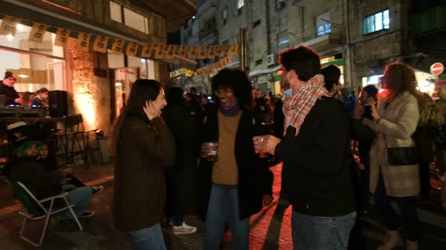young israelis dance outside a bar during the annual shaon horef open culture festival on march 17 in downtown jerusalem, israel. following the... - israel stock videos & royalty-free footage