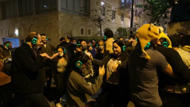 young israelis dance to music during a silent disco party for the annual shaon horef open culture festival on march 17 in downtown jerusalem, israel.... - israel stock videos & royalty-free footage