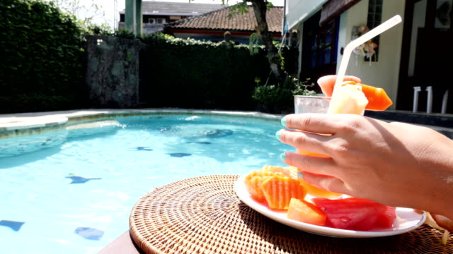 young italian girl enjoying the sun and a healthy juice at the pool in a private villa in bali - privacy stock videos & royalty-free footage