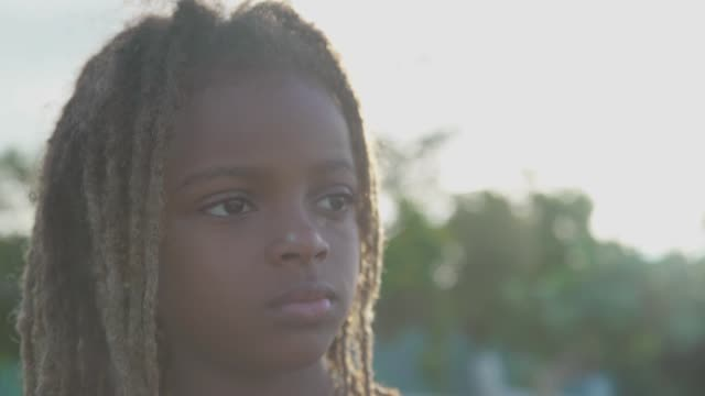young jamaican girl looking out into the sea - jamaican ethnicity stock videos and b-roll footage