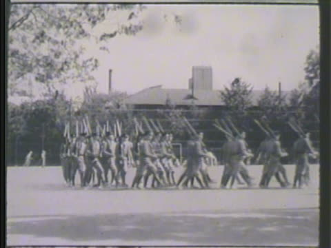 young japanese cadets soldiers w/ rifles at rest marching in formation in courtyard vs cadets standing in line drill master instructor shouting... - drill instructor stock videos & royalty-free footage