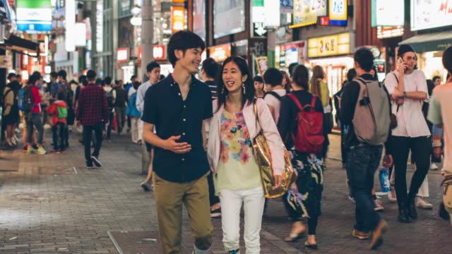 Young Japanese couple hanging ou in Shibuya