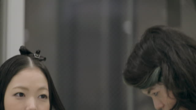 young japanese female in a hair salon. - hair accessory stock videos and b-roll footage