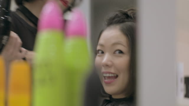 young japanese female in a hair salon. - hair conditioner stock videos and b-roll footage