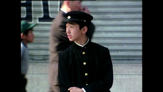 ms young japanese schoolboy waits on street; 1975 - 日本の学生服点の映像素材/bロール
