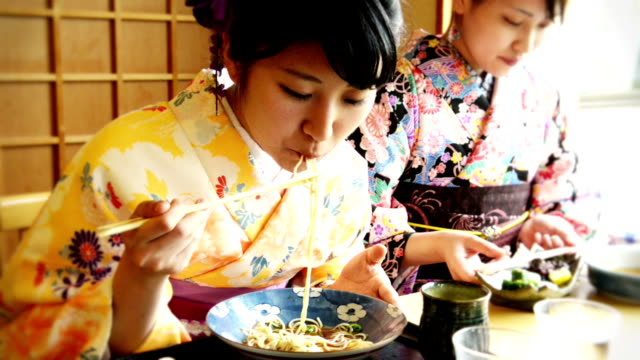 young japanese woman eating out - kimono stock videos & royalty-free footage