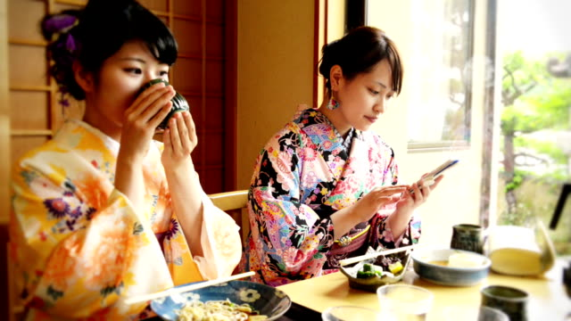 Young Japanese woman eating out