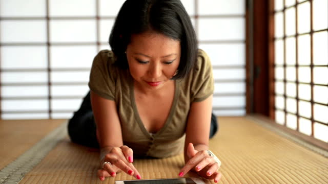 young japanese woman using digital tablet - tatami mat stock videos and b-roll footage
