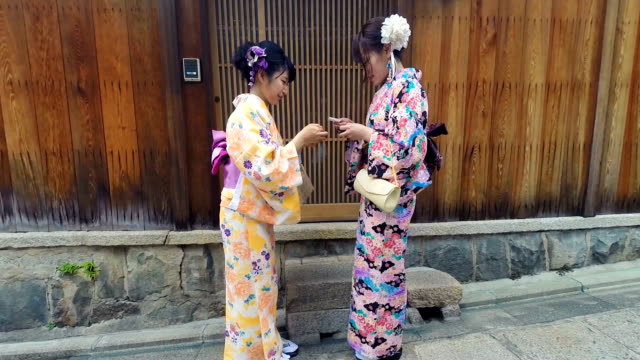young japanese women meeting while wearing traditional kimonos - gion stock videos and b-roll footage